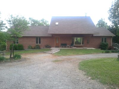 brick ranch, pool, hot tub, lower walk out with rec room, game area, and bar