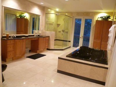 Large master bath with big jacuzzi tub, bidet, and private balcony.