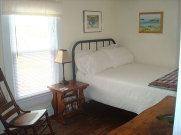 Second Bedroom has double bed & air conditioner.