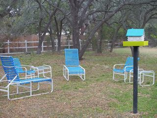Dripping Springs house photo - Backyard offers plenty of seating, a great area for birdwatching and playing.