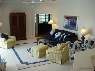 East Naples house photo - Living room with Cable TV in Armoir Opens to Pool & Lanai