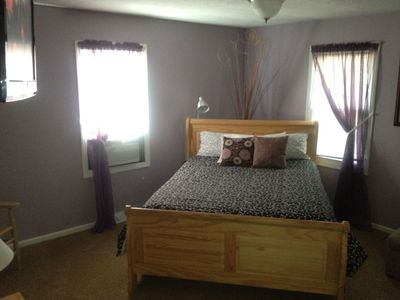 Master bedroom (queen) with hanging flat screen TV