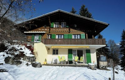 Chalet on a sunny hillside with beautiful view on the village and the mountains