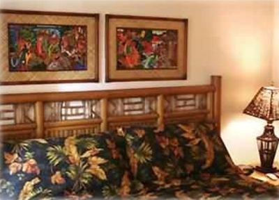 2nd bdrm has king bed, colorful Hawiian art, TV, fan and air conditioning