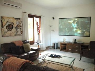 Your own cinema room with full library