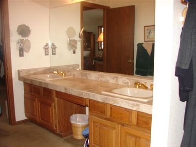 A large master bath with jet tub & shower plus an added large bath & shower .