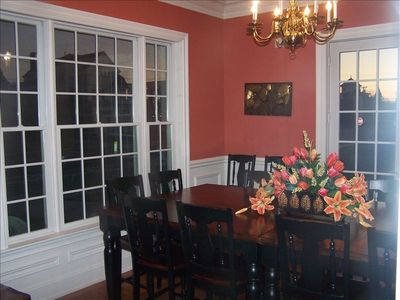 large formal dining room with ocean views and french doors to front porch