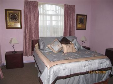 Front bedroom with queen size foam mattress, with cozy quilt and lots of pillows