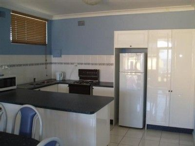 The Entrance apartment rental - The beachside flat's kitchen is fully equipped