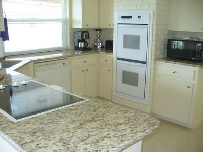 Open Kitchen with granite counters, double oven, microwave, and lots more