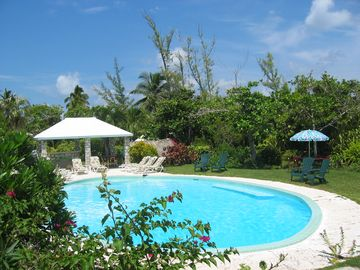 Our secluded pool and bar, with bath