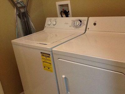 Washer and dryer, with ironing board and iron, Laundry baskets in all bedrooms