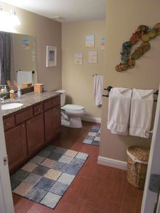 Hallway bathroom also includes granite countertops, toilet, shower/tub