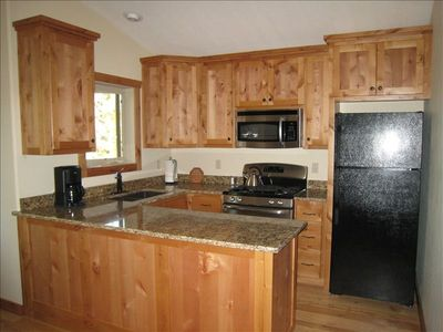Kitchen, granite counters and great view of Big Mountain in Whitefish Range