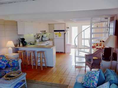 Bethany Beach townhome rental - Kitchen/dining area with circular staircase rising to second and third levels