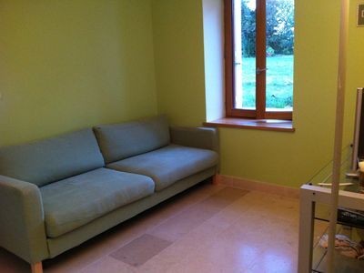 Saint-Malo-en-Donziois farmhouse rental - TV room with sofabed