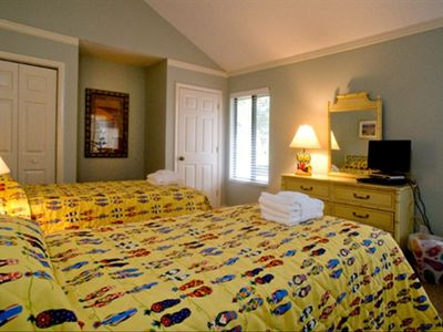Downstairs flip flop theme bedroom w/ 2 twin beds and adjacent full bath