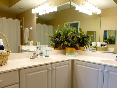 Master bathroom is bright and clean with a garden tub and shower.