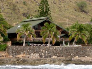 Makaha house photo - A huge deck (lanai) to watch spinner dolphins, winter whales and monk seals!