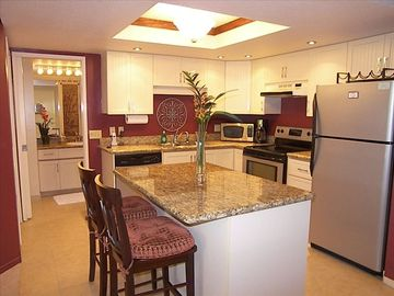 Clean well stocked kitchen with granite counters unit T204
