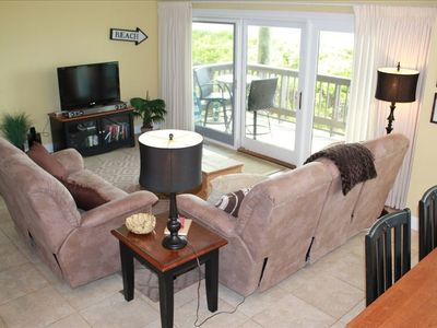 cozy family room with flat screen tv, dvd player and direct beach access