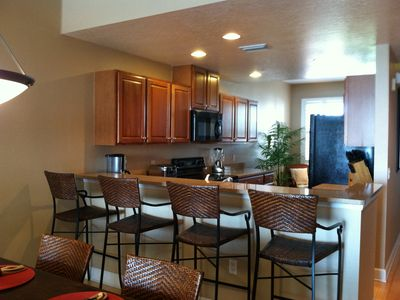 Plenty of seating for guests overlooking the spacious, well-appointed kitchen.