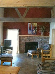 Great room with vaulted ceilings and a wood burning fireplace