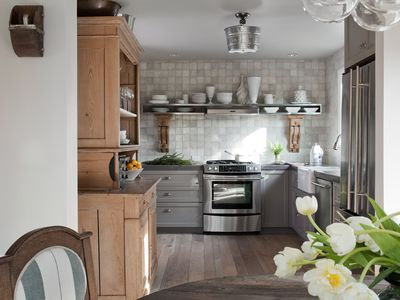 A gourmet kitchen with hand painted tiles and all the tools of the trade.