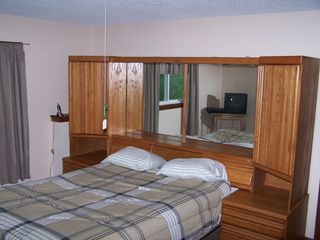 Lake Bomoseen house photo - Queen size bed in one of the four rooms.