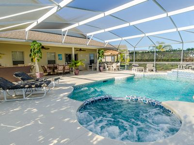 Huge south facing private pool spa and deck with plenty of loungers and tables.