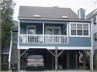 Two story cottage on stilts shore vrbo for 2 story beach house
