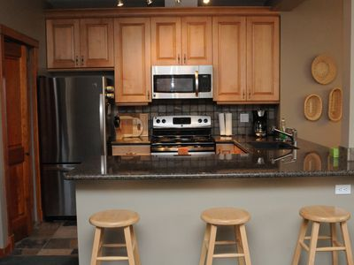 Stainless appliances, Maple cabinets and Granite counter adjacent to Dining area