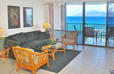 Living room has spectacular oceanfront views of island of Molokai and Pacific.