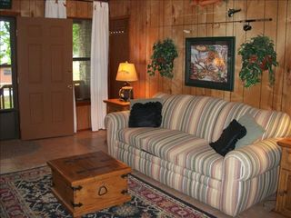 Kingsland house photo - Right side of living room with queen size sleeper sofa