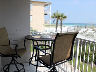 Fort Walton Beach condo photo - New pub-height table with four chairs on balcony