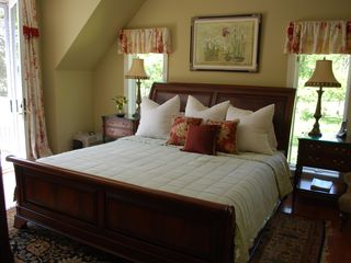 Oconomowoc house photo - Master suite #1 features a king bed and private stone bathroom with a hot tub