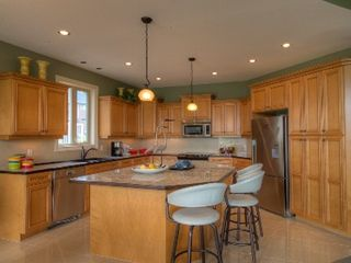 Kelowna house photo - Very large kitchen, fully equipped, with wine storage, & lots of cupboards.