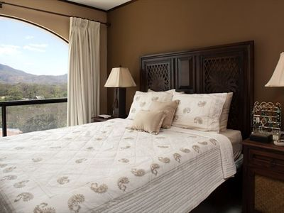Bedroom with ocean/mountain views and queen bed