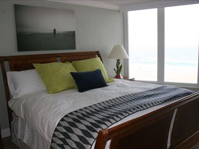 Master bedroom, facing beach with a balcony access.