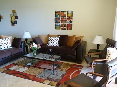 Living room. Unwind and sink into the incredibly comfortable couches or chairs!