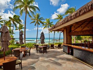 Ko Olina villa photo - Beach Villas tiki bar with ocean front seating - live music once a week.