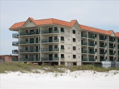 New well-maintained building directly off the beach