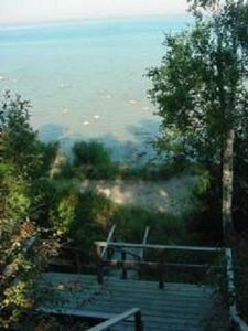 Port Sanilac house rental - landing on stairs down to the lake