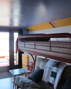 Remodel boat paddle room with futon and twin bunk walk out with open side lights