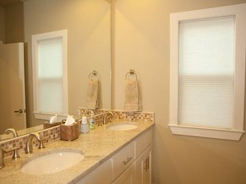 Master bath with dual sinks, granite countertop, mosaic tile, designer fixtures