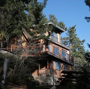 View of the back of the cottage, with a deck facing the ocean.