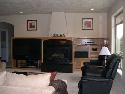 "Enjoy the large living room with High Def 60"" TV, and plenty of space to relax"