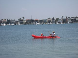 Naples house photo - Kayaking on the bay. Naples in the background.