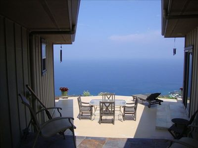 Outdoor lanai dining and lounging area with endless horizon view. Gas grill.