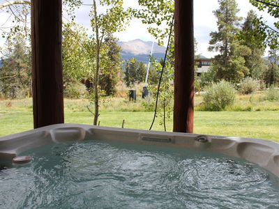 Enjoy your private hot tub while you watch the skiers go by